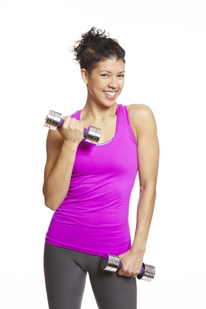 individual sport: Young woman exercising in sports outfit holding dumbbells on white background
