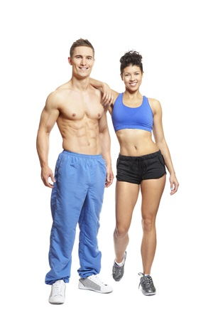 Young man and woman relaxing in sports outfits on white background smiling  photo