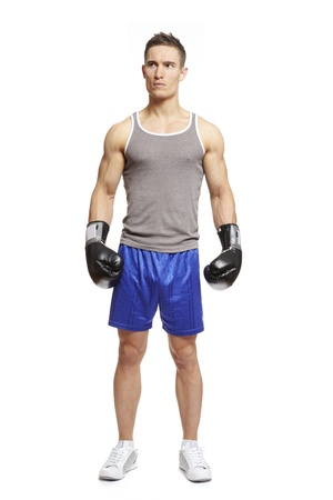 Muscular young man with boxing gloves in sports outfit on white background photo