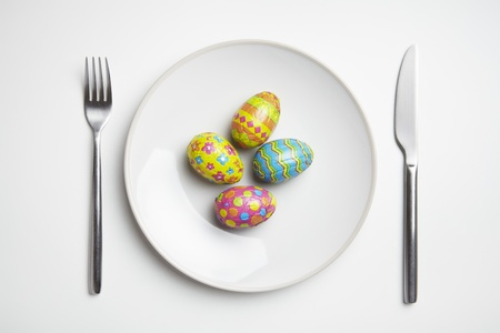Chocolate Easter Eggs On Plate With Knife And Fork Photo