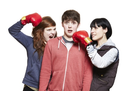 Teenage siblings fighting with boxing gloves on white background photo