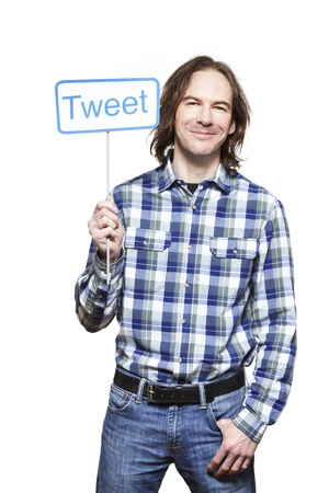 socialise: Young man holding a social media sign smiling on white background Stock Photo