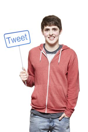 socialise: Teenage boy holding a social media sign smiling on white background