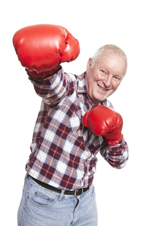 red gloves: Senior man wearing boxing gloves smiling on white background