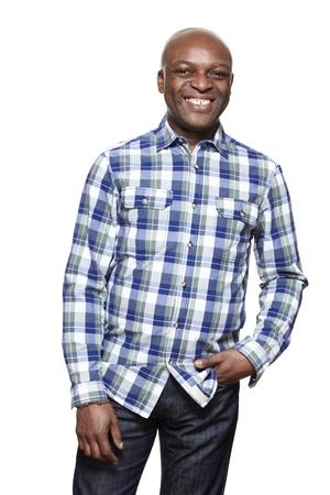 afro caribbean: Casually dressed man smiling on white background