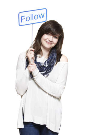 socialise: Young woman holding a social media sign smiling on white background