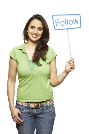 joyfully: Young asian woman holding a social media sign smiling on white background