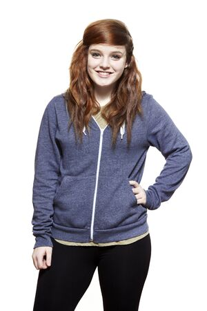 casually: Casually dressed teenage girl smiling on white background Stock Photo