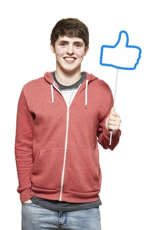 joyfully: Teenage boy holding a social media sign smiling on white background