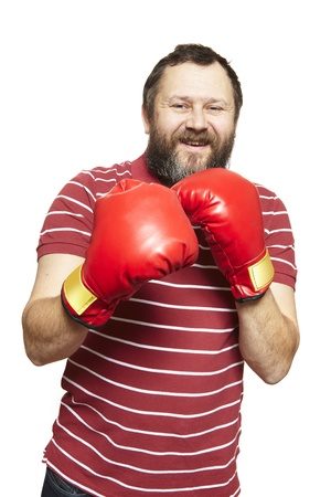 red gloves: Man wearing boxing gloves smiling on white background