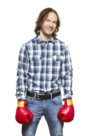 Man wearing boxing gloves smiling on white background Stock Photo - 18815899