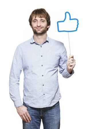 Young man holding a social media sign smiling on white background Stock Photo