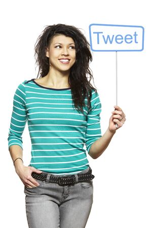 Young woman holding a social media sign smiling on white background Stock Photo - 18823094