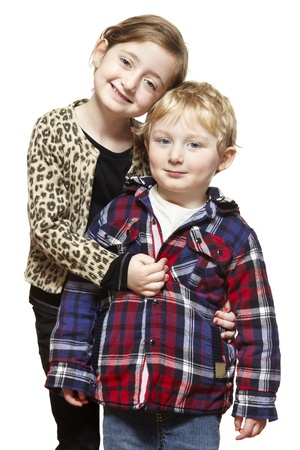 4 5 year old: Young boy and girl smiling on white background Stock Photo