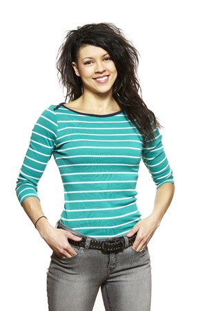 casually dressed: Casually dressed young woman smiling on white background