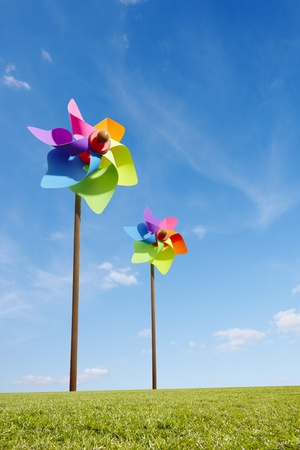 Toy windmill concept of green energy wind farm in field photo