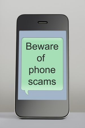 Mobile phone with scam text message speech bubble