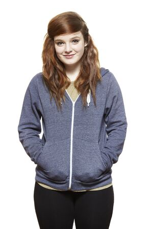 casually dressed: Casually dressed teenage girl smiling on white background Stock Photo