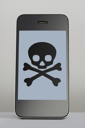 Mobile phone with skull and crossbones on the screen on grey background