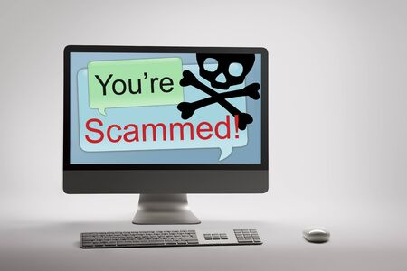 warns: Desktop computer displaying conceptual internet fraud and scam warning on screen