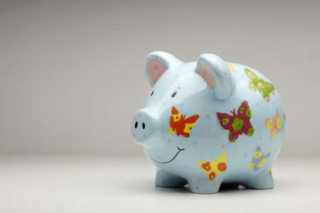 Colourful ceramic piggy bank isolated on plain background photo