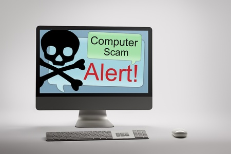 scam: Desktop computer displaying conceptual internet fraud and scam warning on screen