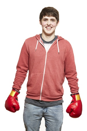 boy boxing: Young teenage boy wearing boxing gloves smiling on white background