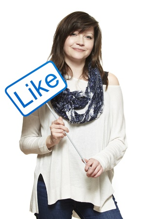joyfully: Young woman holding a social media sign smiling on white background