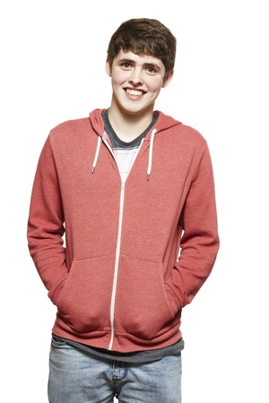 casually: Casually dressed teenage boy smiling on white background