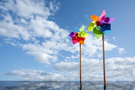 Toy windmill concept of green energy wind farm at sea Foto de archivo