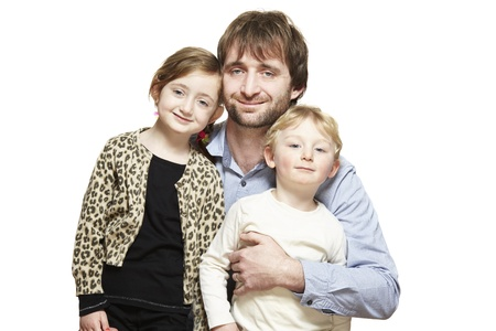 cuteness: Dad, son and daughter family group smiling on white background