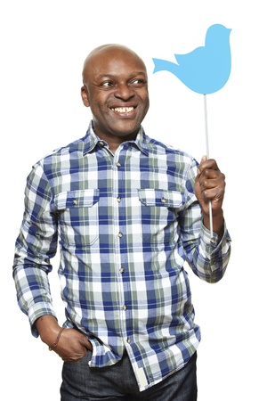 american media: Man holding a social media sign smiling on white background