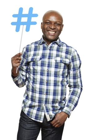 african american ethnicity: Man holding a social media sign smiling on white background