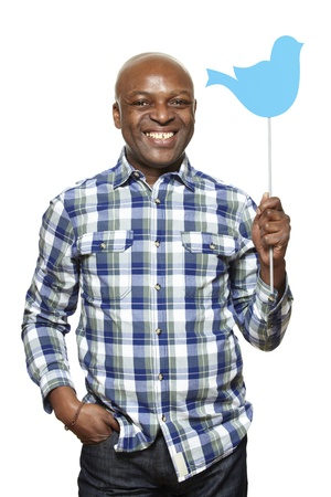 afro caribbean ethnicity: Man holding a social media sign smiling on white background