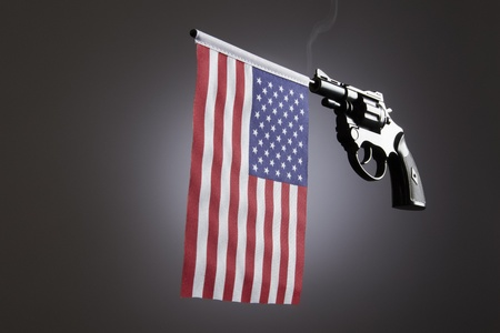 shootings: Gun crime concept of hand pistol showing the flag of united states of america