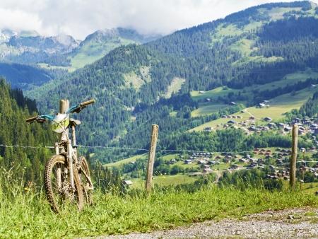 bike trail: Mountain bike in summer Alps landscape France Stock Photo