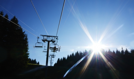 chair lift: Mountain bikers on Alps chair lift Morzine France Stock Photo