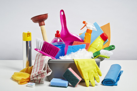 home keeping: House cleaning products pile. Household chore concept on white background