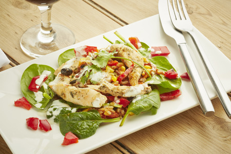chicken salad: Chicken salad on white dish and wooden table top