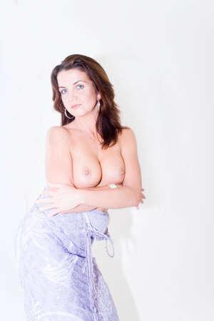 A topless female in a dress