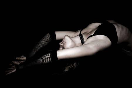 Sexy female posing wearing black fishnets & gloves