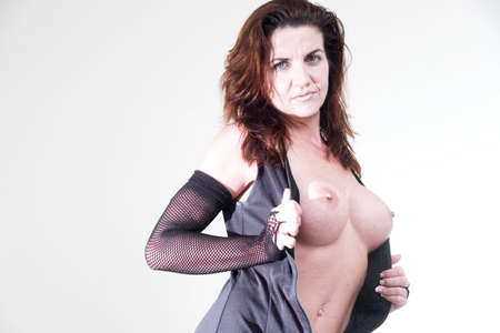 sexy female in dress showing breasts