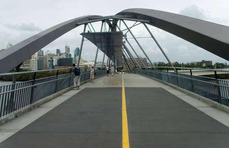 People walking on A City bridge walking path