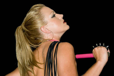 sexy blond female holding a whip