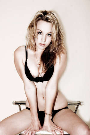 sexy female wearing lingerie sitting on stool