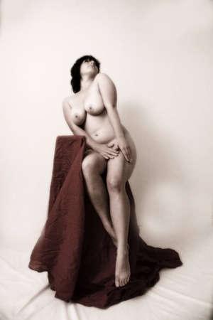 sexy nude sitting on stool
