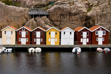 A Row Of Colourful Swedish Fishing Huts Stock Photo