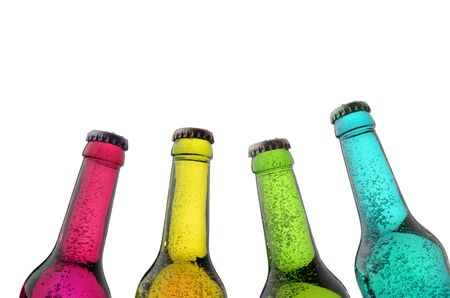 four bottles of different color with sparkling content, isolated, white background Stock Photo