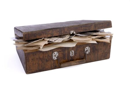old nearly closed wooden box containing old photos, papers and documents, isolated on white background, cut out