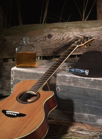 harmonica: Still life with guitar, harmonica, hat and bottle of whiskey, studio shot, digital camera back Stock Photo